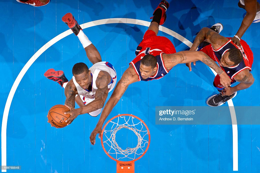 Eric Bledsoe #12 of the Los Angeles Clippers drives to the basket against Trevor Ariza #1 of the Washington Wizards at Staples Center on January 19, 2013 in Los Angeles, California.