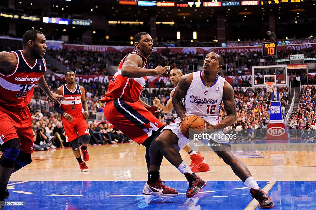 Eric Bledsoe #12 of the Los Angeles Clippers drives to the basket against Kevin Seraphin #13 of the Washington Wizards at Staples Center on January 19, 2013 in Los Angeles, California.