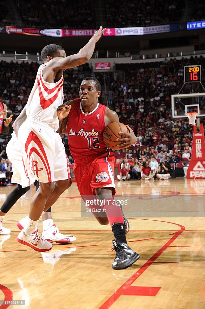 <a gi-track='captionPersonalityLinkClicked' href=/galleries/search?phrase=Eric+Bledsoe&family=editorial&specificpeople=6480906 ng-click='$event.stopPropagation()'>Eric Bledsoe</a> #12 of the Los Angeles Clippers drives to the basket against Aaron Brooks #0 of the Houston Rockets on March 30, 2013 at the Toyota Center in Houston, Texas.