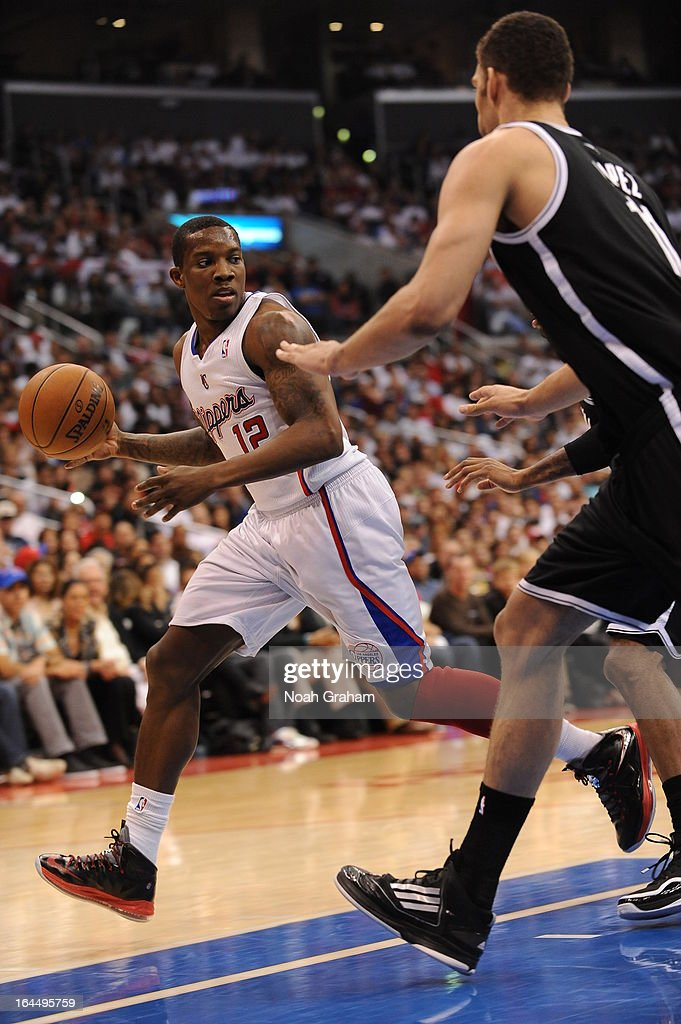 Eric Bledsoe #12 of the Los Angeles Clippers drives under pressure during the game between the Los Angeles Clippers and the Brooklyn Nets at Staples Center on March 23, 2013 in Los Angeles, California.