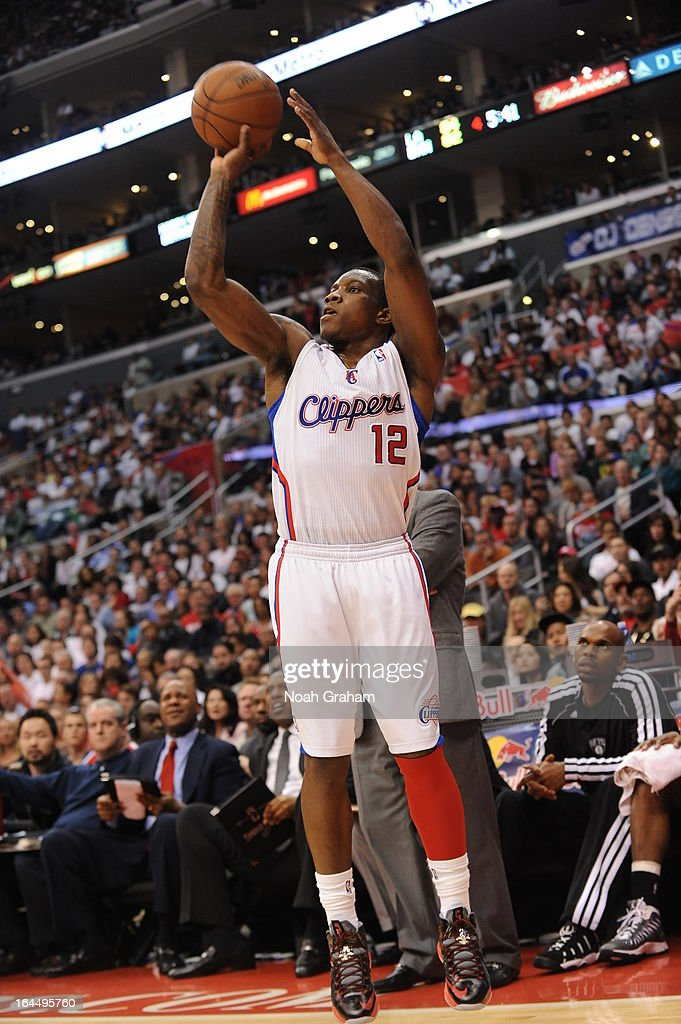 Eric Bledsoe #12 of the Los Angeles Clippers goes for a jump shot during the game between the Los Angeles Clippers and the Brooklyn Nets at Staples Center on March 23, 2013 in Los Angeles, California.