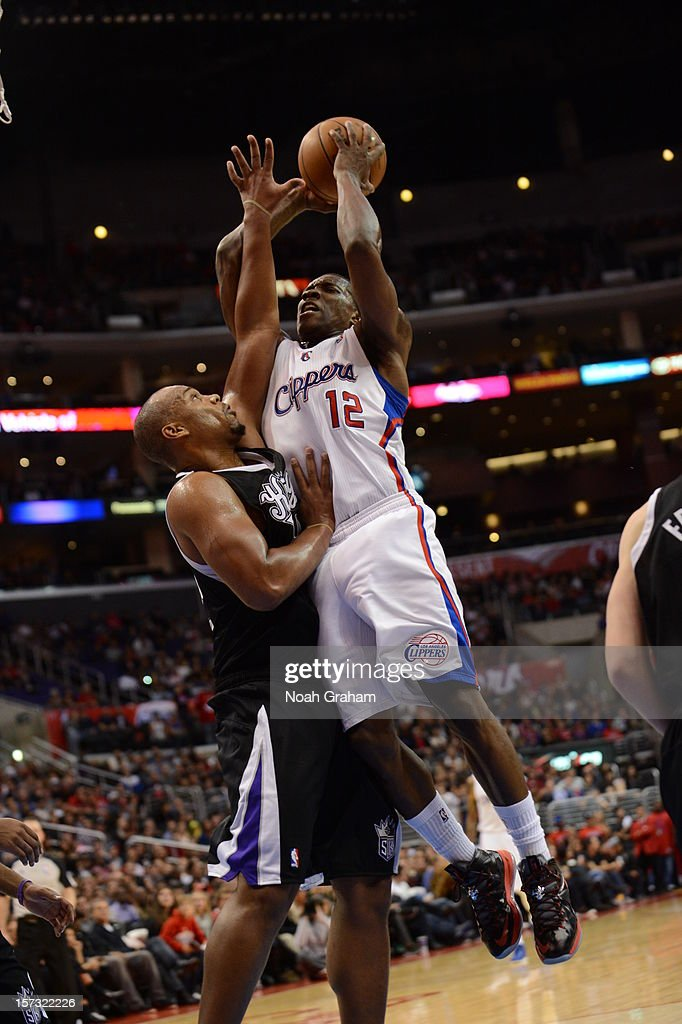 Eric Bledsoe #12 of the Los Angeles Clippers goes to the basket under pressure during the game between the Los Angeles Clippers and the Sacramento Kings at Staples Center on December 1, 2012 in Los Angeles, California.
