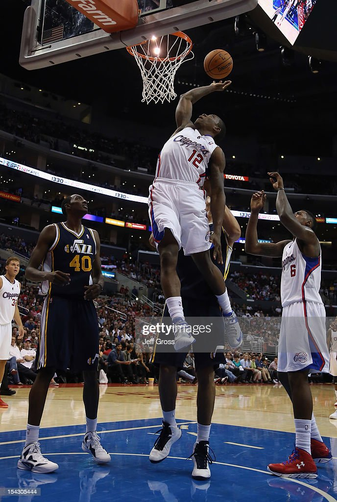 <a gi-track='captionPersonalityLinkClicked' href=/galleries/search?phrase=Eric+Bledsoe&family=editorial&specificpeople=6480906 ng-click='$event.stopPropagation()'>Eric Bledsoe</a> #12 of the Los Angeles Clippers goes up for a rebound past Jeremy Evans #40 of the Utah Jazz during the first half of a preseason game at Staples Center on October 17, 2012 in Los Angeles, California. The Clippers defeated the Jazz 96-94.