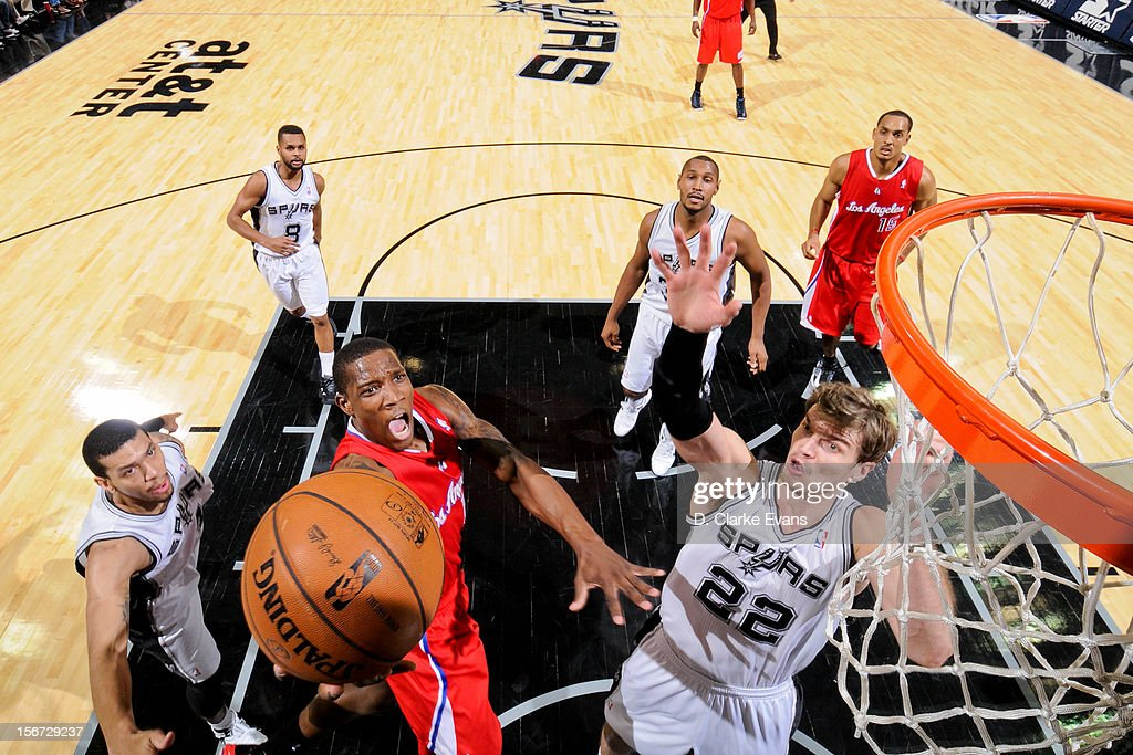 <a gi-track='captionPersonalityLinkClicked' href=/galleries/search?phrase=Eric+Bledsoe&family=editorial&specificpeople=6480906 ng-click='$event.stopPropagation()'>Eric Bledsoe</a> #12 of the Los Angeles Clippers shoots a layup against <a gi-track='captionPersonalityLinkClicked' href=/galleries/search?phrase=Tiago+Splitter&family=editorial&specificpeople=208218 ng-click='$event.stopPropagation()'>Tiago Splitter</a> #22 of the San Antonio Spurs on November 19, 2012 at the AT&T Center in San Antonio, Texas.