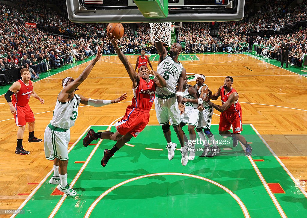 Eric Bledsoe #12 of the Los Angeles Clippers shoots the ball against Paul Pierce #34 and Kevin Garnett #5 of the Boston Celtics on February 3, 2013 at the TD Garden in Boston, Massachusetts.