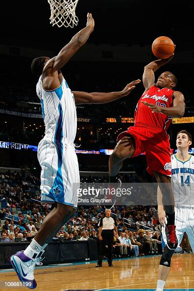 Eric Bledsoe of the Los Angeles Clippers shoots the ball over Emeka Okafor of the New Orleans Hornets at the New Orleans Arena on November 9 2010 in...