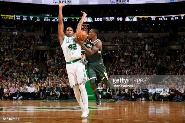 Eric Bledsoe of the Milwaukee Bucks handles the ball against Al Horford of the Boston Celtics on December 4 2017 at the TD Garden in Boston...