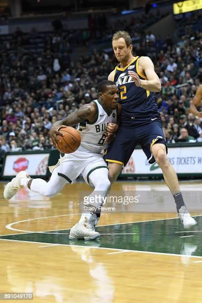 Eric Bledsoe of the Milwaukee Bucks works against Joe Ingles of the Utah Jazz during a game at the Bradley Center on December 9 2017 in Milwaukee...