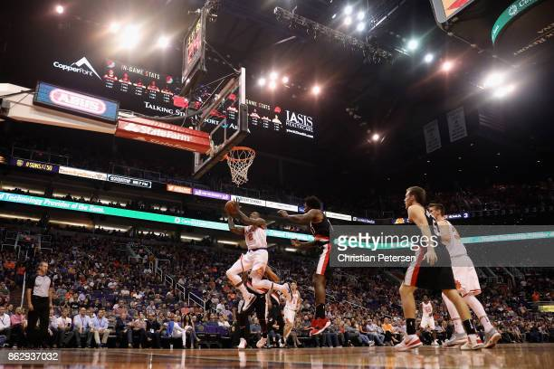 Eric Bledsoe of the Phoenix Suns attempts a lay up against the Portland Trail Blazers during the first half of the NBA game at Talking Stick Resort...
