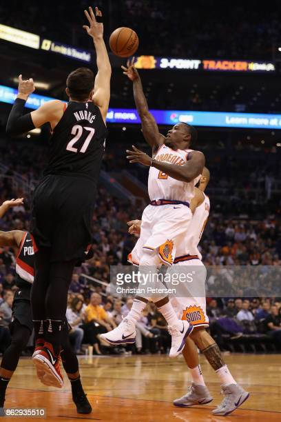 Eric Bledsoe of the Phoenix Suns attempts a shot against Jusuf Nurkic of the Portland Trail Blazers during the first half of the NBA game at Talking...