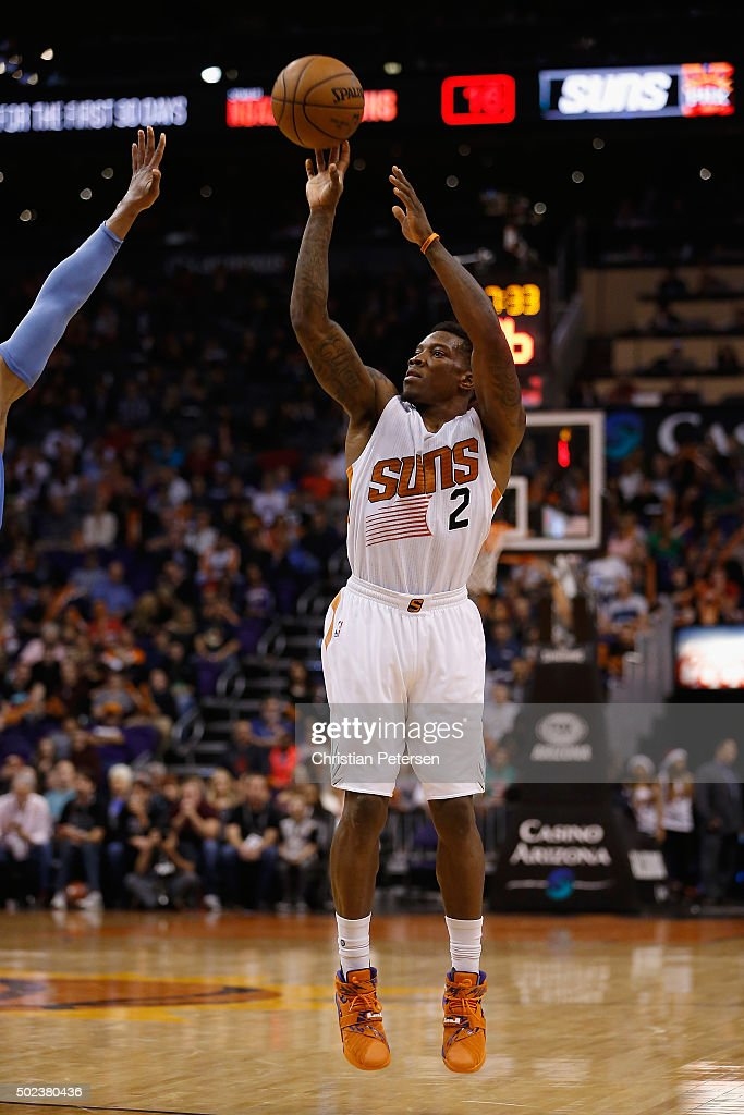 Eric Bledsoe #2 of the Phoenix Suns attempts a shot against the Denver Nuggets during the second half of the NBA game at Talking Stick Resort Arena on December 23, 2015 in Phoenix, Arizona. The Nuggets defeated the Suns 104-96.