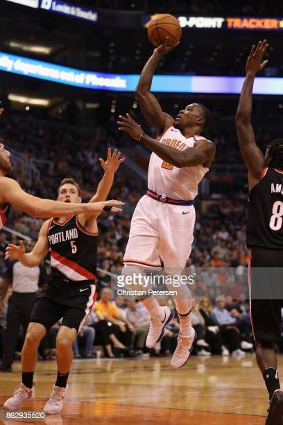Eric Bledsoe of the Phoenix Suns attempts a shot over Connaughton of the Portland Trail Blazers during the first half of the NBA game at Talking...