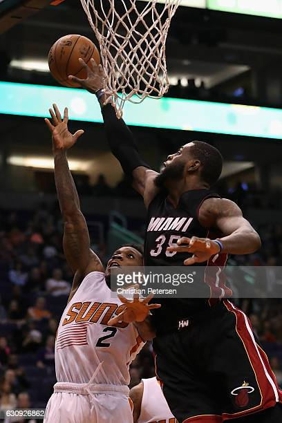 Eric Bledsoe of the Phoenix Suns attempts a shot past Willie Reed of the Miami Heat during the second half of the NBA game at Talking Stick Resort...