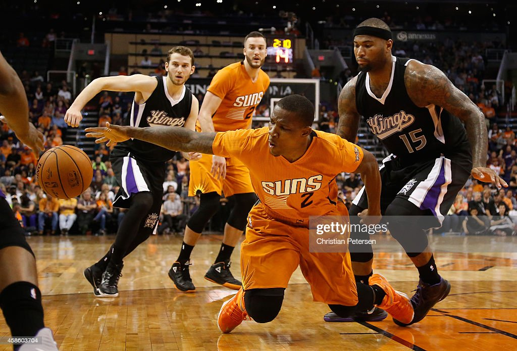 Eric Bledsoe #2 of the Phoenix Suns attempts to control a loose ball defended by DeMarcus Cousins #15 of the Sacramento Kings during the second half of the NBA game at US Airways Center on November 7, 2014 in Phoenix, Arizona. The Kings defeated the Suns 114-112 in double overtime.
