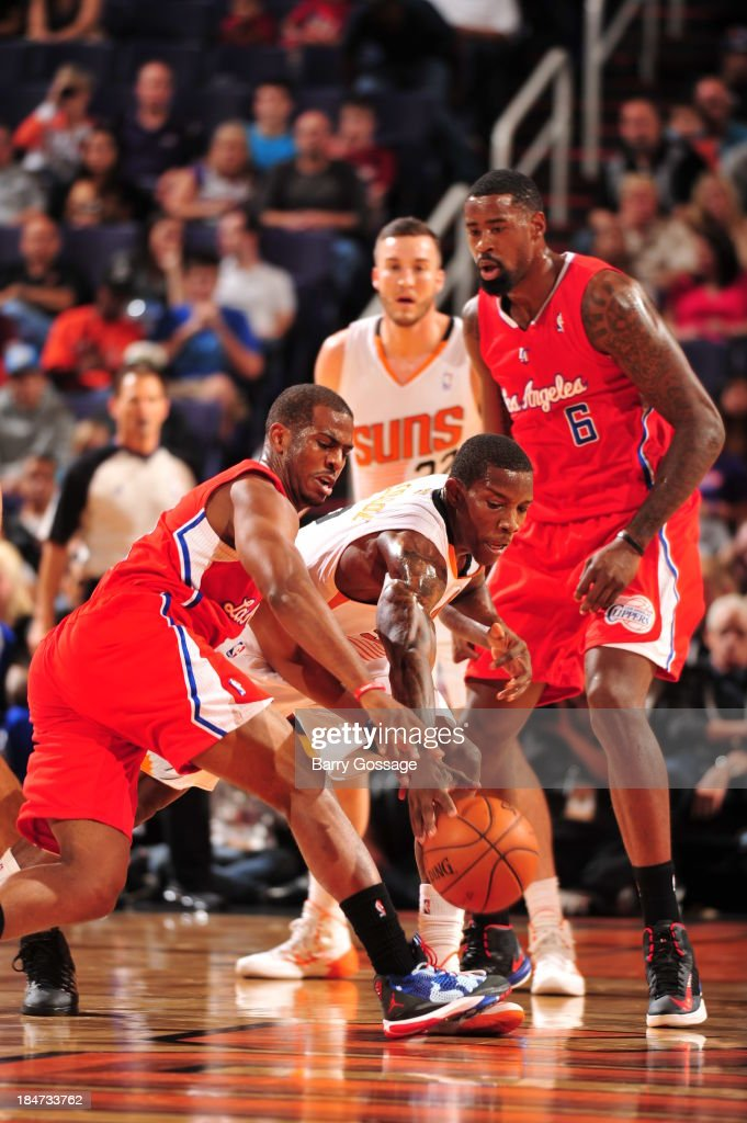 <a gi-track='captionPersonalityLinkClicked' href=/galleries/search?phrase=Eric+Bledsoe&family=editorial&specificpeople=6480906 ng-click='$event.stopPropagation()'>Eric Bledsoe</a> #2 of the Phoenix Suns battles for a loose ball against <a gi-track='captionPersonalityLinkClicked' href=/galleries/search?phrase=Chris+Paul&family=editorial&specificpeople=212762 ng-click='$event.stopPropagation()'>Chris Paul</a> #3 of the Los Angeles Clipper on October 15, 2013 at U.S. Airways Center in Phoenix, Arizona.