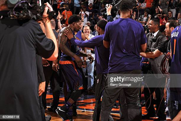 Eric Bledsoe of the Phoenix Suns celebrates with his team after making the game winning three point basket in overtime against the Portland Trail...