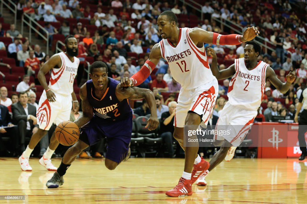 <a gi-track='captionPersonalityLinkClicked' href=/galleries/search?phrase=Eric+Bledsoe&family=editorial&specificpeople=6480906 ng-click='$event.stopPropagation()'>Eric Bledsoe</a> #2 of the Phoenix Suns dribbles past <a gi-track='captionPersonalityLinkClicked' href=/galleries/search?phrase=Dwight+Howard&family=editorial&specificpeople=201570 ng-click='$event.stopPropagation()'>Dwight Howard</a> #12 of the Houston Rockets during the game at Toyota Center on December 4, 2013 in Houston, Texas.