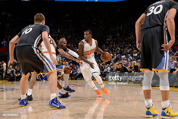 Eric Bledsoe of the Phoenix Suns drives against Leandro Barbosa of the Golden State Warriors on January 31 2015 at Oracle Arena in Oakland California...