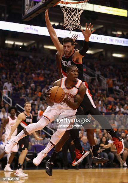 Eric Bledsoe of the Phoenix Suns drives the ball past Jusuf Nurkic of the Portland Trail Blazers during the first half of the NBA game at Talking...