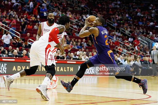 Eric Bledsoe of the Phoenix Suns drives to the basket as Patrick Beverley of the Houston Rockets looks on during their game at the Toyota Center on...