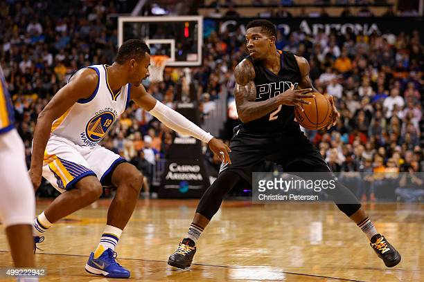 Eric Bledsoe of the Phoenix Suns handles the ball against Leandro Barbosa of the Golden State Warriors during the NBA game at Talking Stick Resort...