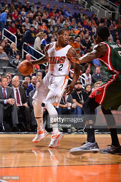 Eric Bledsoe of the Phoenix Suns is guarded by Larry Sanders of the Milwaukee Bucks on December 15 2014 at US Airways Center in Phoenix Arizona NOTE...