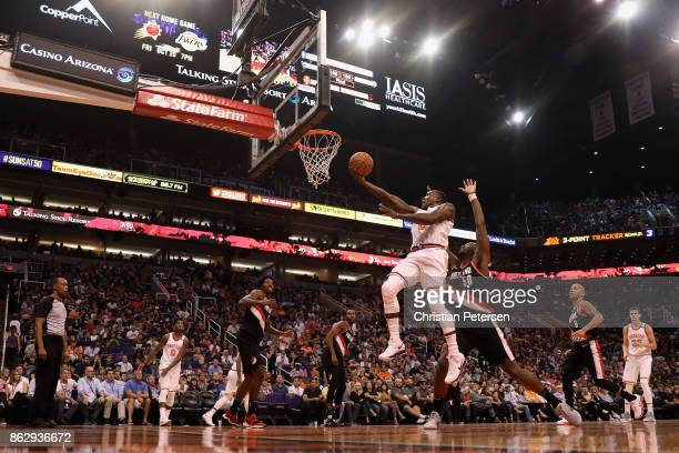 Eric Bledsoe of the Phoenix Suns lays up a shot past Caleb Swanigan of the Portland Trail Blazers during the first half of the NBA game at Talking...