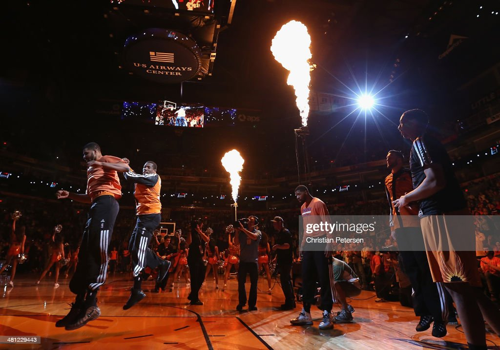 Eric Bledsoe #2 (second from left) of the Phoenix Suns leaps in the air as he is introduced to the NBA game against the New York Knicks at US Airways Center on March 28, 2014 in Phoenix, Arizona.