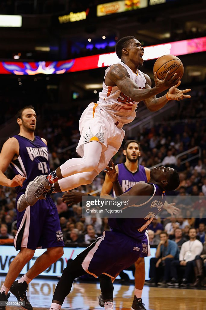 Eric Bledsoe #2 of the Phoenix Suns leaps over Darren Collison #7 of the Sacramento Kings as he attempts a shot during the second half of the NBA game at Talking Stick Resort Arena on November 4, 2015 in Phoenix, Arizona. The Suns defeated the Kings 118-97.