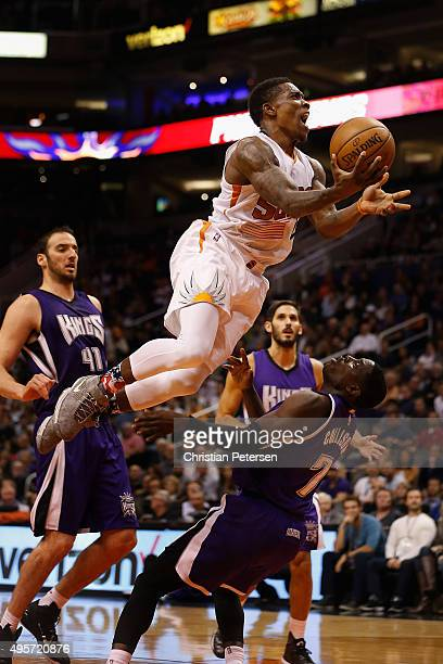 Eric Bledsoe of the Phoenix Suns leaps over Darren Collison of the Sacramento Kings as he attempts a shot during the second half of the NBA game at...