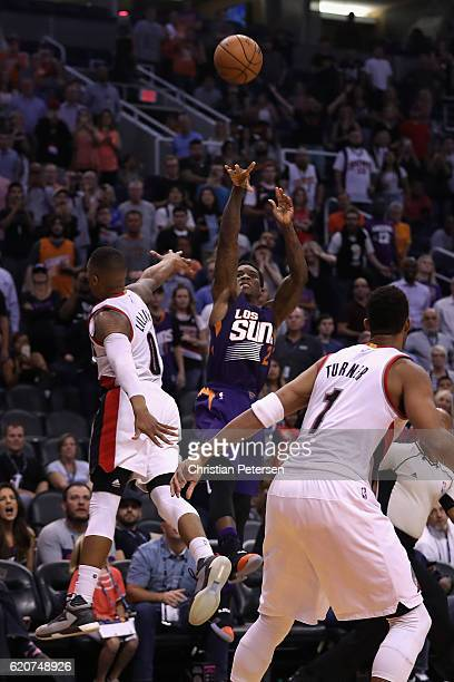 Eric Bledsoe of the Phoenix Suns puts up the game winning three point shot past Damian Lillard of the Portland Trail Blazers during the final seconds...
