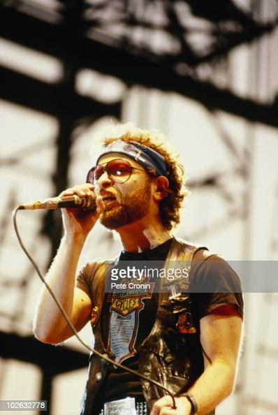 Eric Bloom of Blue Oyster Cult performs on stage in 1984