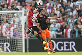 Eric Botteghin of Feyenoord Fernando Garcia of Valencia CF during the preseason friendly match between Feyenoord and Valencia on July 23 2016 at the...