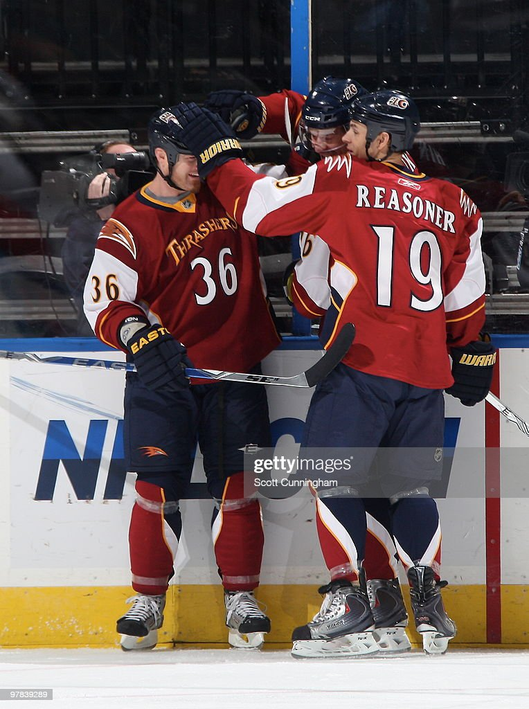 Eric Boulton #36 and Marty Reasoner #19 of the Atlanta Thrashers congratulate Evgeny Artyukhin #76 after scoring a first period goal against the Ottawa Senators at Philips Arena on March 18, 2010 in Atlanta, Georgia.