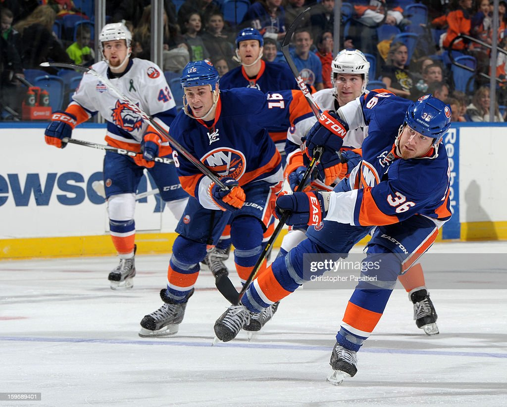 Eric Boulton #36 of Team Blue takes a shot on goal during a scrimmage match between players of the New York Islanders and Bridgeport Sound Tigers on January 16, 2013 at Nassau Veterans Memorial Coliseum in Uniondale, New York.