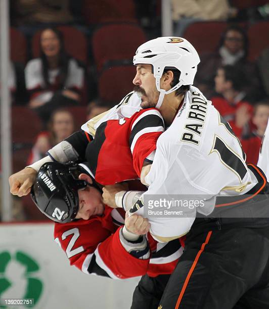 Eric Boulton of the New Jersey Devils and George Parros of the Anaheim Ducks fight during the first period at the Prudential Center on February 17...