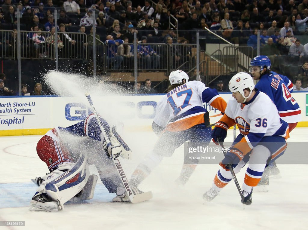 <a gi-track='captionPersonalityLinkClicked' href=/galleries/search?phrase=Eric+Boulton&family=editorial&specificpeople=217746 ng-click='$event.stopPropagation()'>Eric Boulton</a> #36 of the New York Islanders gets a two minute penalty for unsportsmanlike conduct for spraying <a gi-track='captionPersonalityLinkClicked' href=/galleries/search?phrase=Henrik+Lundqvist&family=editorial&specificpeople=217958 ng-click='$event.stopPropagation()'>Henrik Lundqvist</a> #30 of the New York Rangers with ice at Madison Square Garden on December 20, 2013 in New York City.