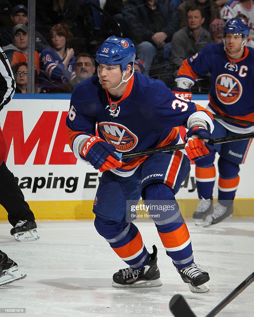 <a gi-track='captionPersonalityLinkClicked' href=/galleries/search?phrase=Eric+Boulton&family=editorial&specificpeople=217746 ng-click='$event.stopPropagation()'>Eric Boulton</a> #36 of the New York Islanders skates against the New York Rangers at the Nassau Veterans Memorial Coliseum on March 7, 2013 in Uniondale, New York. The Rangers defeated the Islanders 2-1 in overtime.