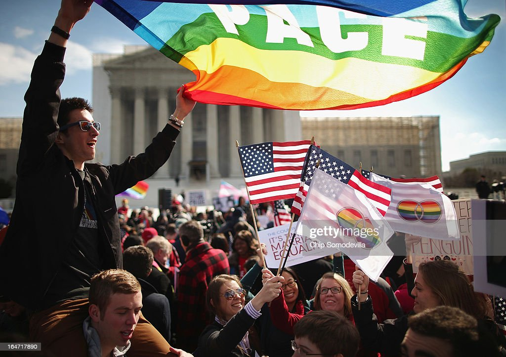 Eric Breese (L) of Rochester, New York, joins fellow George Washington University students and hundreds of others to rally outside the Supreme Court during oral arguments in a case challenging the Defense of Marriage Act (DOMA) March 27, 2013 in Washington, DC. The Supreme Court will hear arguments in the second case this week about same-sex marriage.