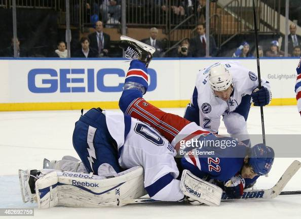 Eric Brewer and Ben Bishop of the Tampa Bay Lightning defend against Brian Boyle of the New York Rangers during the second period at Madison Square...