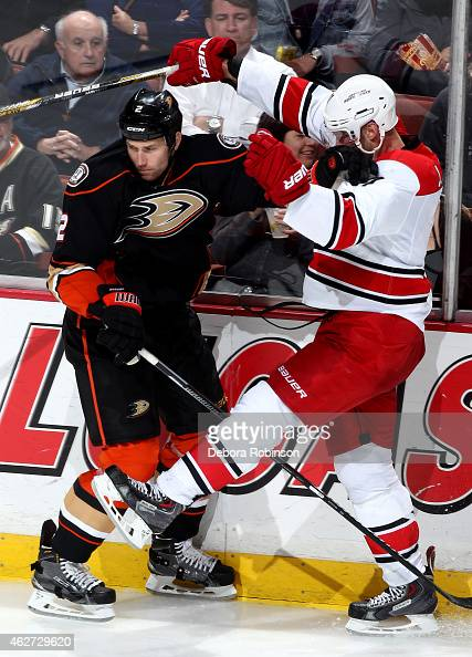 Eric Brewer of the Anaheim Ducks battles for position against Jordan Staal of the Carolina Hurricanes on February 3 2015 at Honda Center in Anaheim...