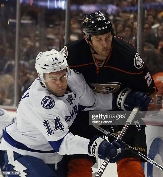 Eric Brewer of the Anaheim Ducks is hit into the boards by Brett Connolly of the Tampa Bay Lightning during the first period at the Honda Center on...