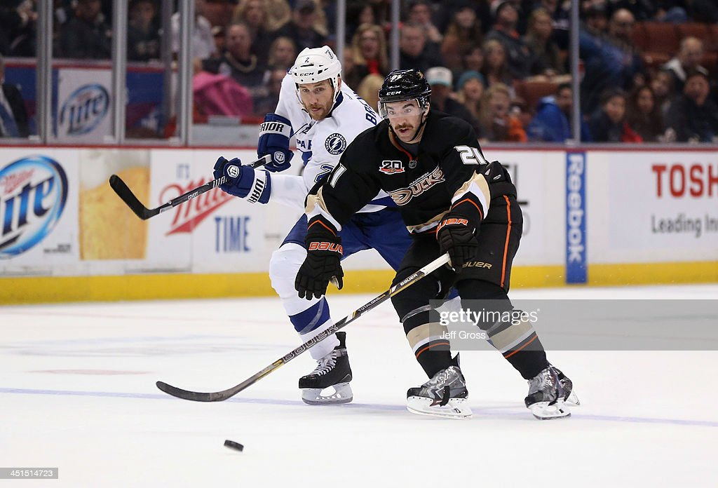 <a gi-track='captionPersonalityLinkClicked' href=/galleries/search?phrase=Eric+Brewer&family=editorial&specificpeople=202144 ng-click='$event.stopPropagation()'>Eric Brewer</a> #2 of the Tampa Bay Lightning and <a gi-track='captionPersonalityLinkClicked' href=/galleries/search?phrase=Kyle+Palmieri&family=editorial&specificpeople=4783296 ng-click='$event.stopPropagation()'>Kyle Palmieri</a> #21 of the Anaheim Ducks fight for the puck in the third period at Honda Center on November 22, 2013 in Anaheim, California. The Ducks defeated the Lightning 1-0 in overtime.
