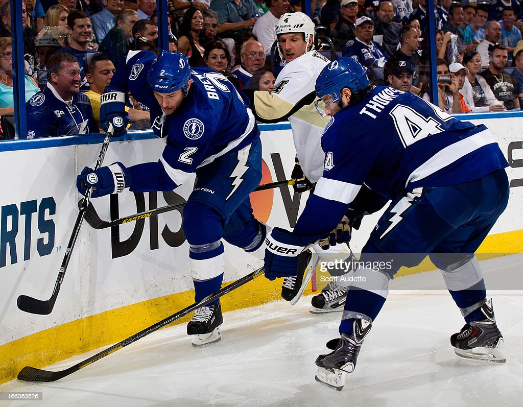 <a gi-track='captionPersonalityLinkClicked' href=/galleries/search?phrase=Eric+Brewer&family=editorial&specificpeople=202144 ng-click='$event.stopPropagation()'>Eric Brewer</a> #2 of the Tampa Bay Lightning and teammate Nate Thompson #44 skate along the boards in the third period of the game against the Pittsburgh Penguins at the Tampa Bay Times Forum on April 11, 2013 in Tampa, Florida.