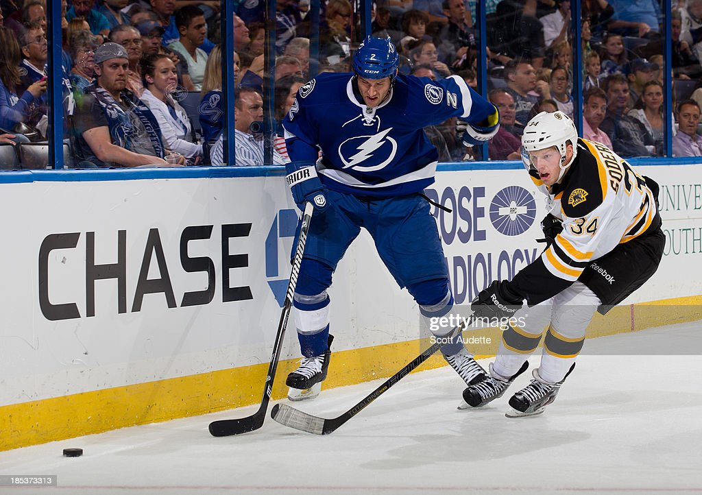 <a gi-track='captionPersonalityLinkClicked' href=/galleries/search?phrase=Eric+Brewer&family=editorial&specificpeople=202144 ng-click='$event.stopPropagation()'>Eric Brewer</a> #2 of the Tampa Bay Lightning battles for the puck against Carl Soderberg #34 of the Boston Bruins during the second period at the Tampa Bay Times Forum on October 19, 2013 in Tampa, Florida.