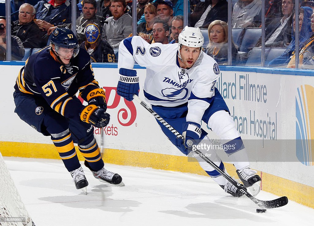 <a gi-track='captionPersonalityLinkClicked' href=/galleries/search?phrase=Eric+Brewer&family=editorial&specificpeople=202144 ng-click='$event.stopPropagation()'>Eric Brewer</a> #2 of the Tampa Bay Lightning carries the puck behind the net against <a gi-track='captionPersonalityLinkClicked' href=/galleries/search?phrase=Tyler+Myers&family=editorial&specificpeople=4595080 ng-click='$event.stopPropagation()'>Tyler Myers</a> #57 of the Buffalo Sabres at First Niagara Center on October 8, 2013 in Buffalo, New York. Tampa defeated Buffalo 3-2.