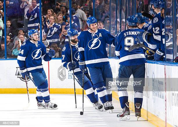 Eric Brewer of the Tampa Bay Lightning celebrates his goal with teammates during the second period against the Columbus Blue Jackets at the Tampa Bay...