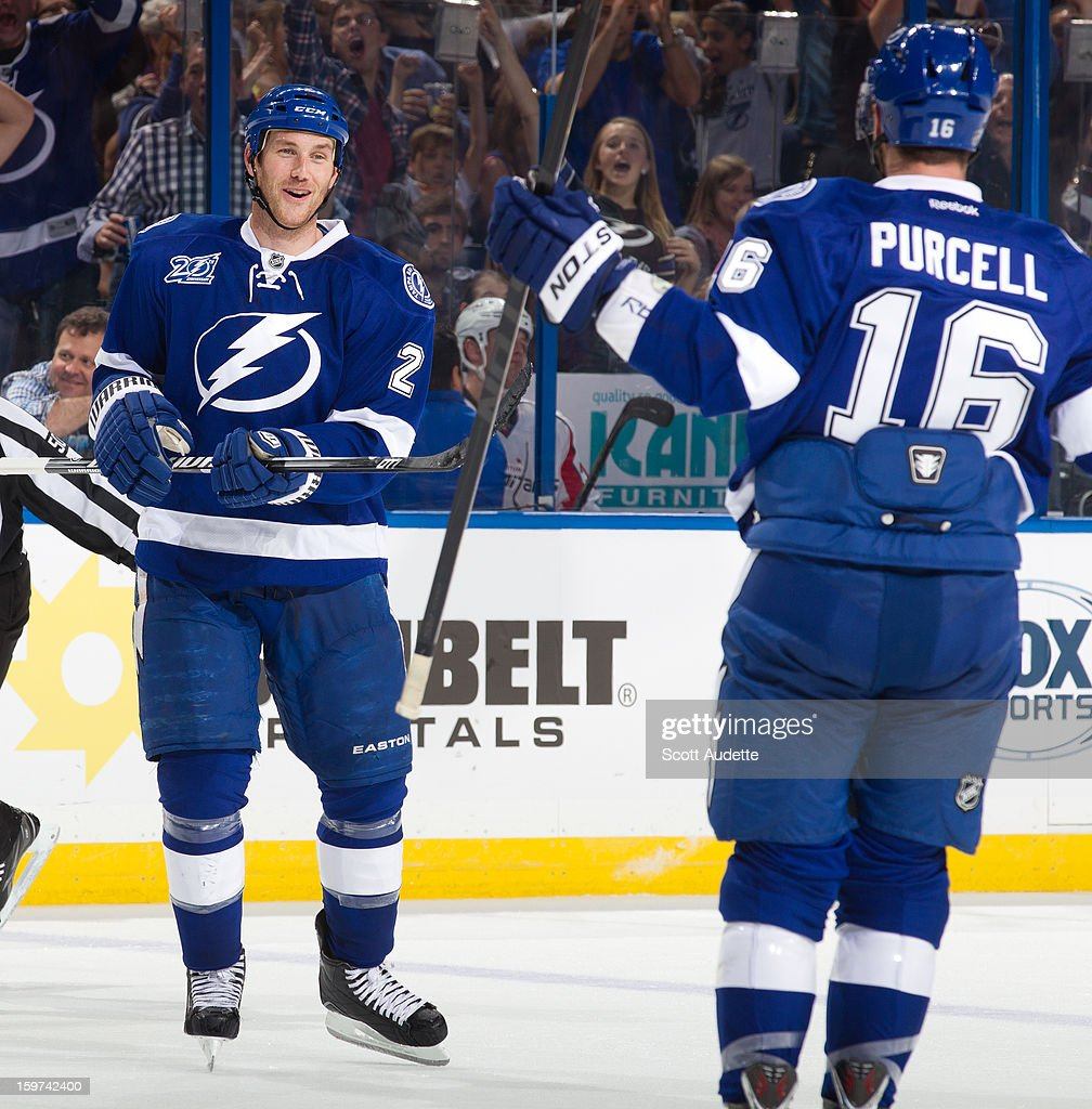 <a gi-track='captionPersonalityLinkClicked' href=/galleries/search?phrase=Eric+Brewer&family=editorial&specificpeople=202144 ng-click='$event.stopPropagation()'>Eric Brewer</a> #2 of the Tampa Bay Lightning celebrates with teammate Teddy Purcell #16 after scoring a goal against the Washington Capitals at the Tampa Bay Times Forum on January 19, 2013 in Tampa, Florida.