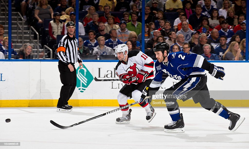 <a gi-track='captionPersonalityLinkClicked' href=/galleries/search?phrase=Eric+Brewer&family=editorial&specificpeople=202144 ng-click='$event.stopPropagation()'>Eric Brewer</a> #2 of the Tampa Bay Lightning chasing after the puck with <a gi-track='captionPersonalityLinkClicked' href=/galleries/search?phrase=Stephen+Gionta&family=editorial&specificpeople=817969 ng-click='$event.stopPropagation()'>Stephen Gionta</a> #11 of the New Jersey Devils during the second period of the game at the Tampa Bay Times Forum on March 29, 2013 in Tampa, Florida. The second period wrapped up with a tie game, 2-2.