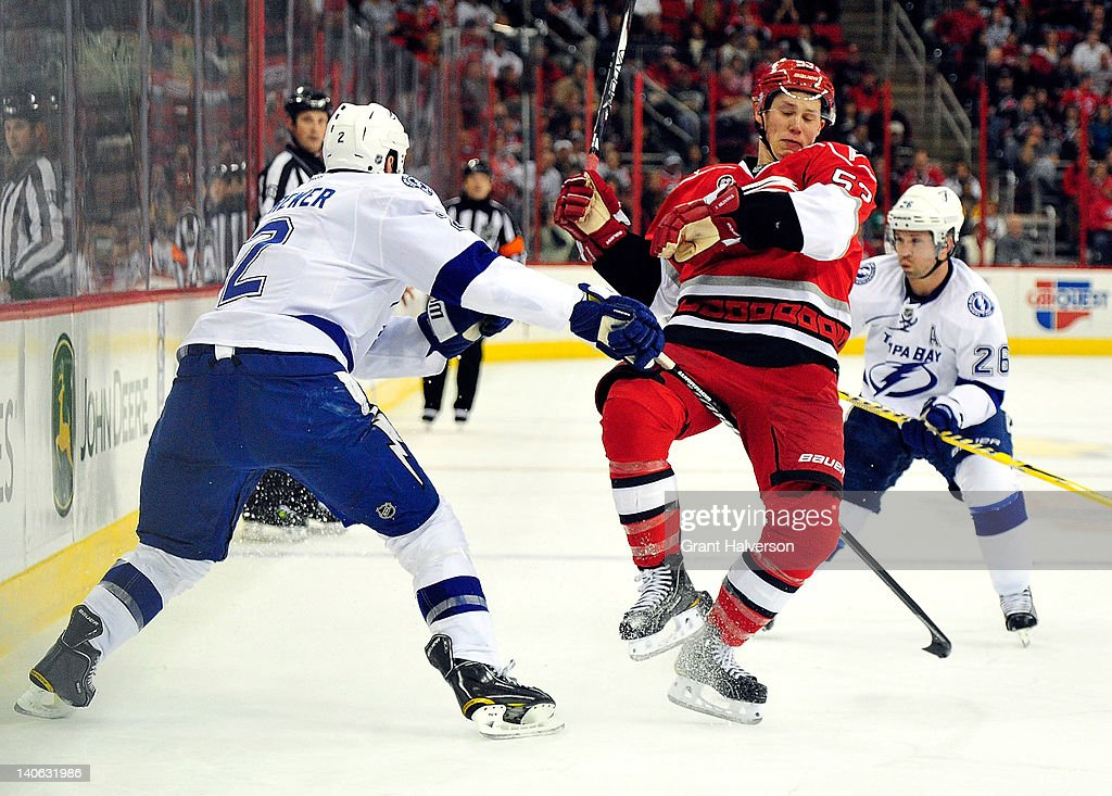 <a gi-track='captionPersonalityLinkClicked' href=/galleries/search?phrase=Eric+Brewer&family=editorial&specificpeople=202144 ng-click='$event.stopPropagation()'>Eric Brewer</a> #2 of the Tampa Bay Lightning collides with <a gi-track='captionPersonalityLinkClicked' href=/galleries/search?phrase=Jeff+Skinner&family=editorial&specificpeople=3147596 ng-click='$event.stopPropagation()'>Jeff Skinner</a> #53 of the Carolina Hurricanes during play at the RBC Center on March 3, 2012 in Raleigh, North Carolina.